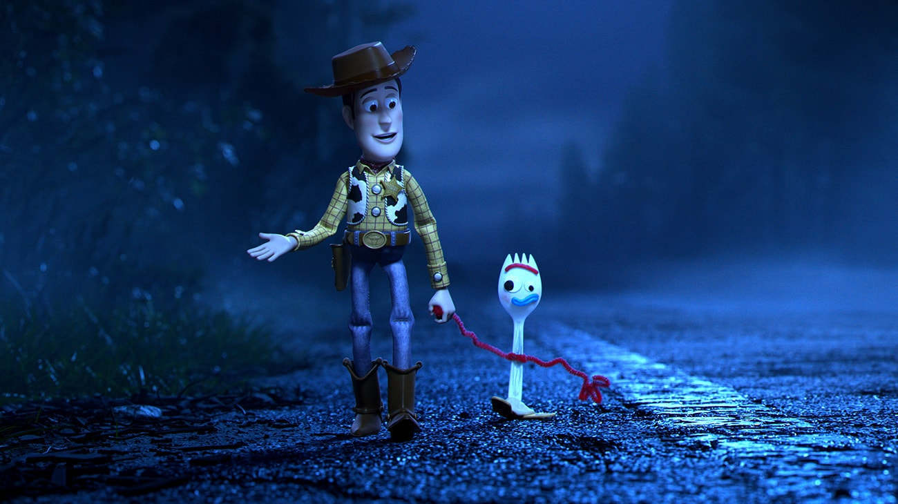 Woody and Forky walk along the road.