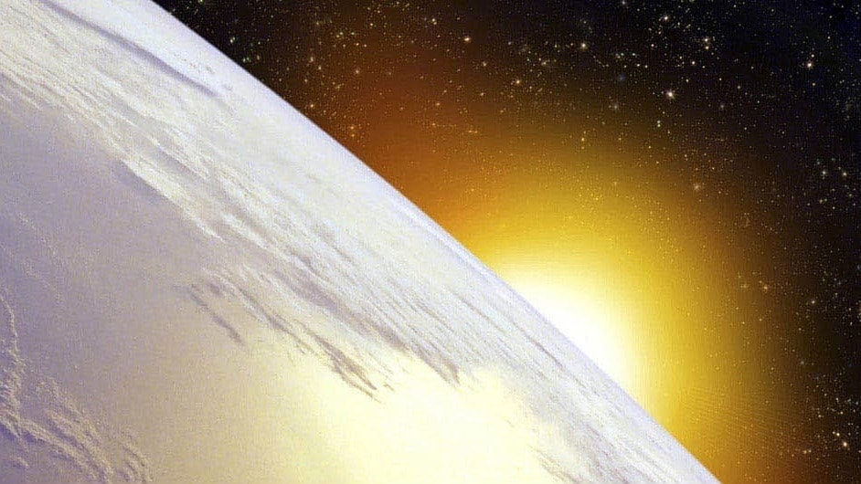 The Sun rising over the Earth from space