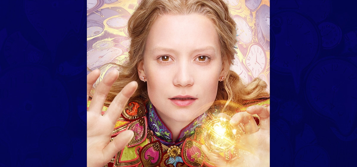 """Mia Wasikowska as Alice Kingsleigh holding a glowing ball in the movie """"Alice Through the Looking Glass"""""""