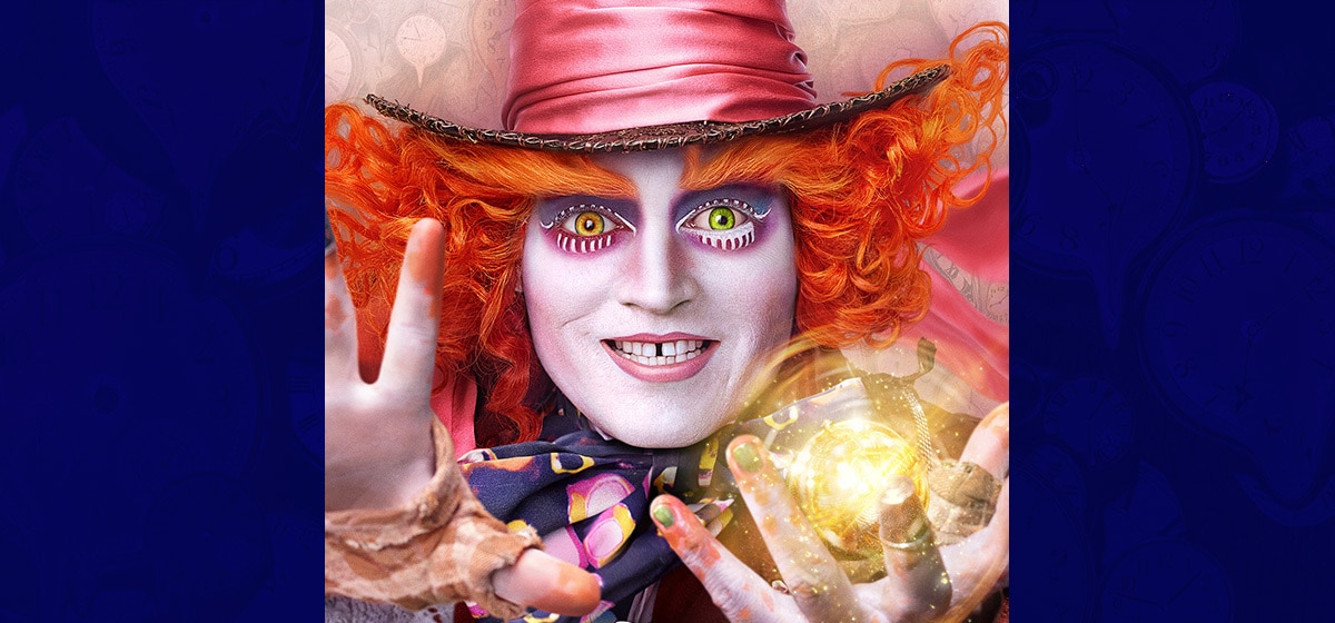 """Johnny Depp as the Mad Hatter holding a glowing ball in the movie """"Alice Through the Looking Glass"""""""