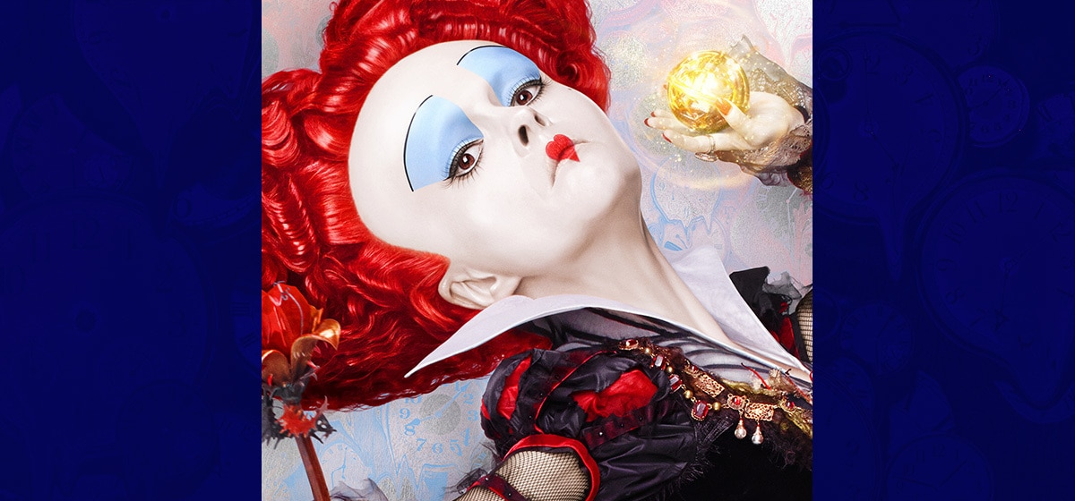 """Helena Bonham Carter as Iracebeth the Red Queen holding a glowing ball in the movie """"Alice Through the Looking Glass"""""""