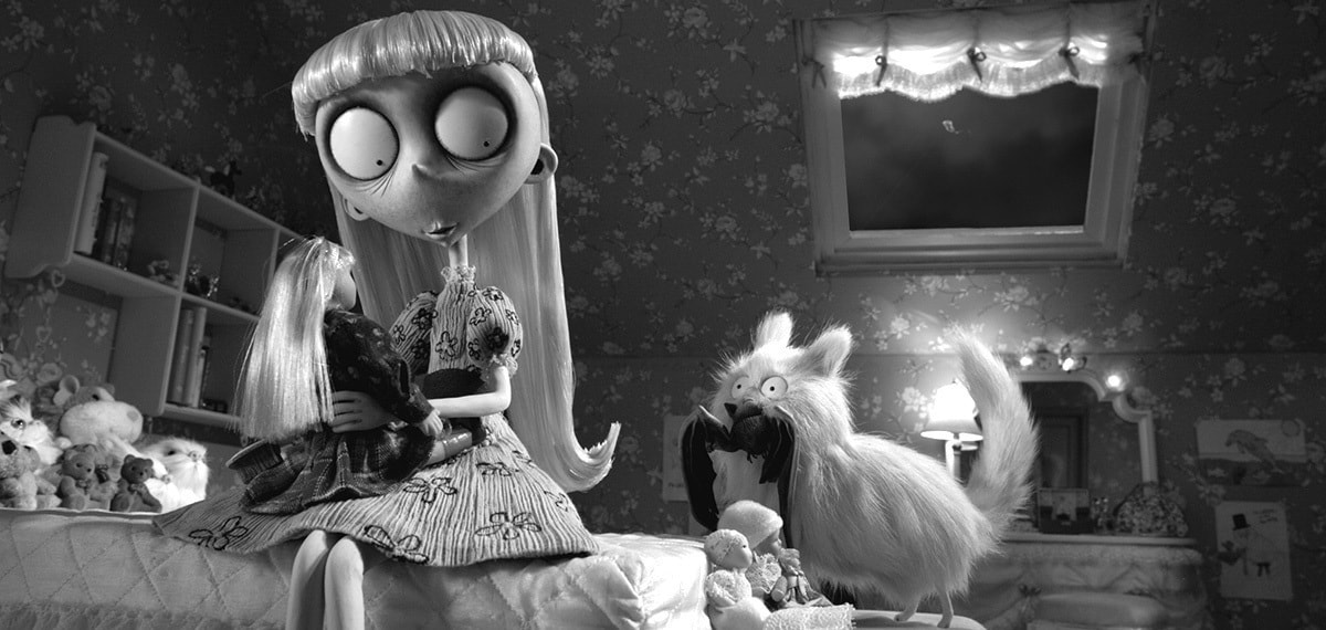 Weird girl holding her doll and looking at her cat