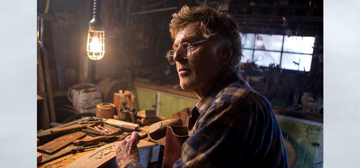 "Robert Redford (Mr. Meacham) in his workshop in ""Pete's Dragon"""