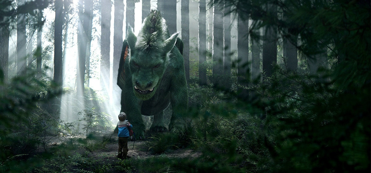 """Oakes Fegley (Pete) and the green dragon from the movie """"Pete's Dragon"""""""