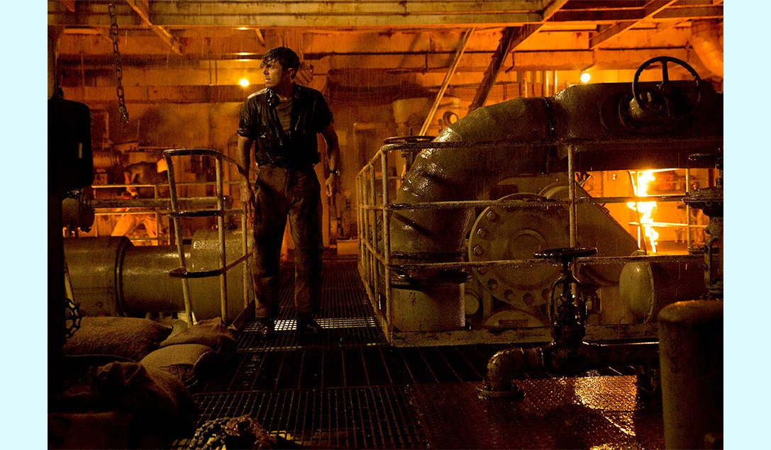 """Ray Sybert (Casey Affleck) walking through a damaged engine room in the movie """"The Finest Hours"""""""
