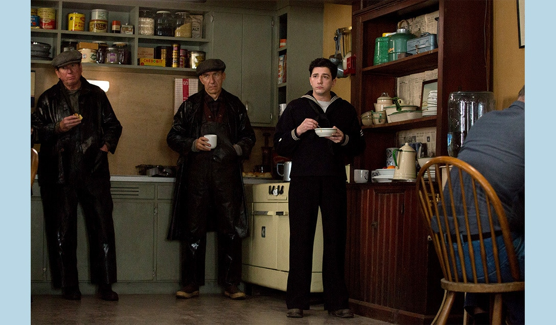 """Sailors standing around a kitchen in the movie """"The Finest Hours"""""""