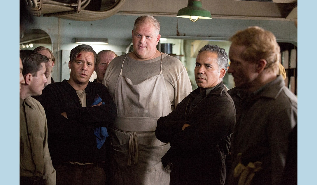 """Crew members on the ship gathered together in the movie """"The Finest Hours"""""""