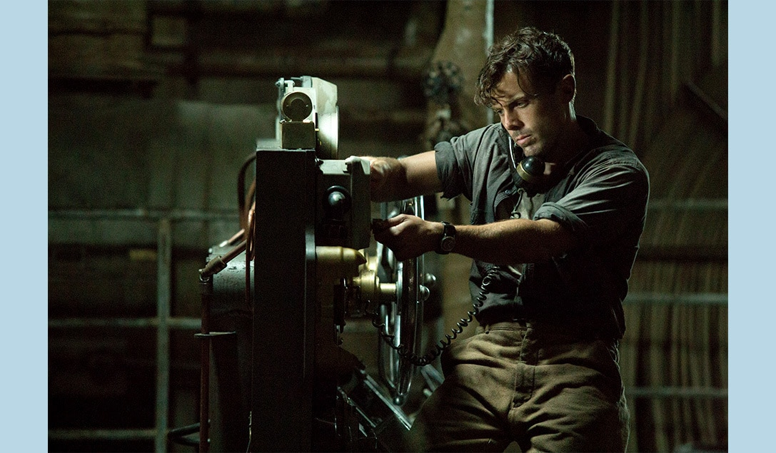 """Ray Sybert (Casey Affleck) talking on a phone in the movie """"The Finest Hours"""""""