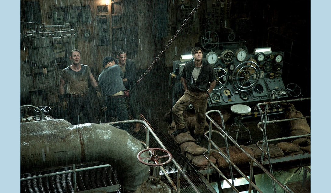 """Desperate crew members at work in the rain in the movie """"The Finest Hours"""""""