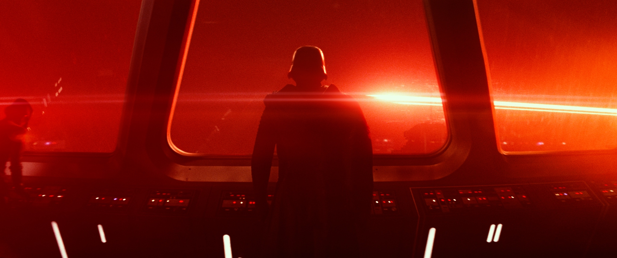 Adam Driver as Kylo Ren stands alone on a starship in the movie Star Wars: The Force Awakens