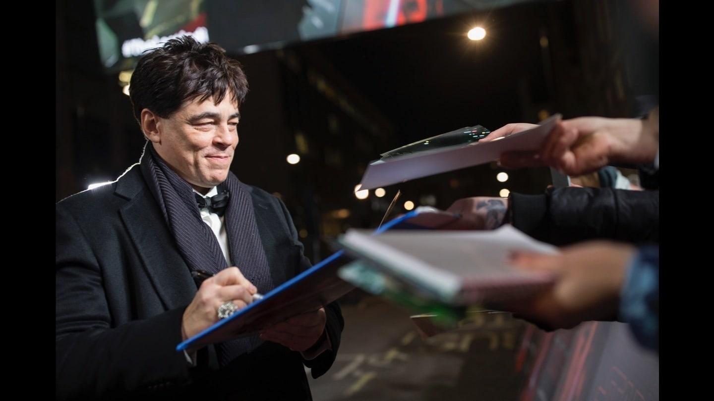 Benicio del Toro signing autographs on the red carpet at the Star: Wars The Last Jedi premiere