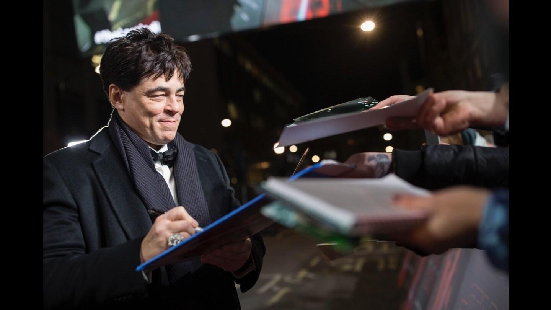 Benicio del Toro signing autographs on the red carpet at the Star: Wars The Last Jedi premiere