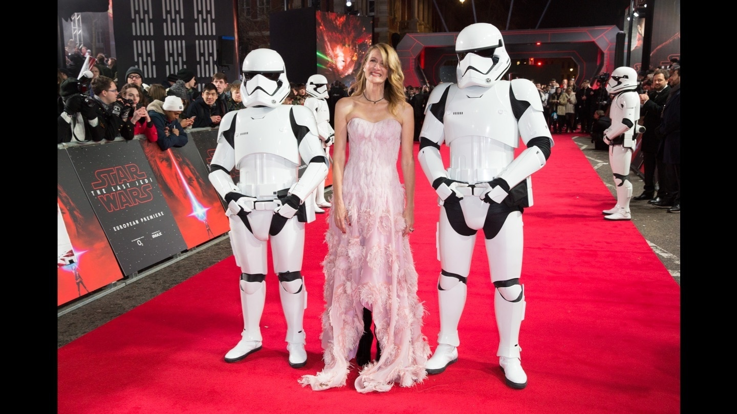 Laura Dem posing with two Stormtroopers on the red carpet at the Star: Wars The Last Jedi premiere