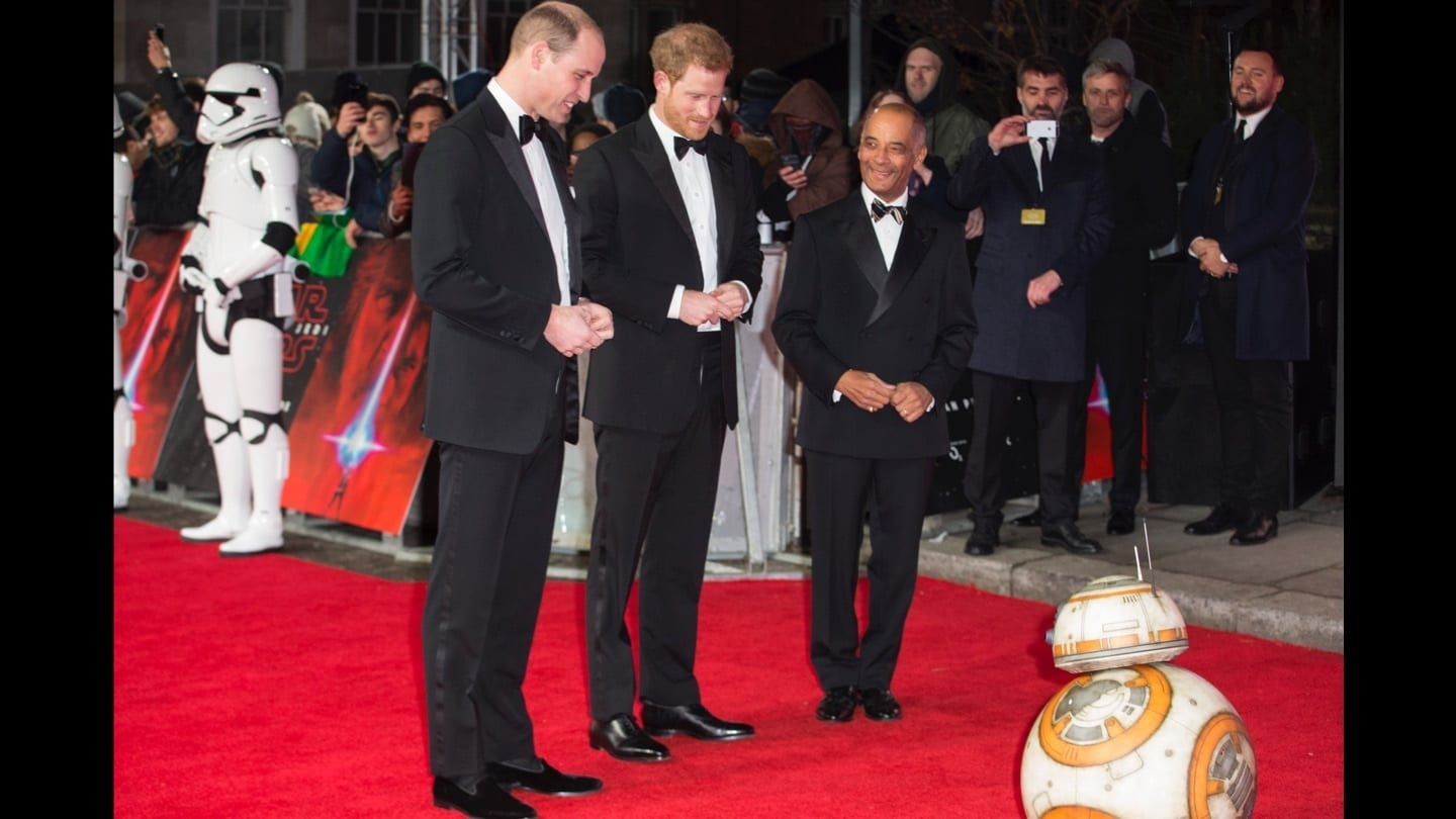 Prince William and Prince Harry looking at BB-8 on the red carpet at the Star: Wars The Last Jedi premiere