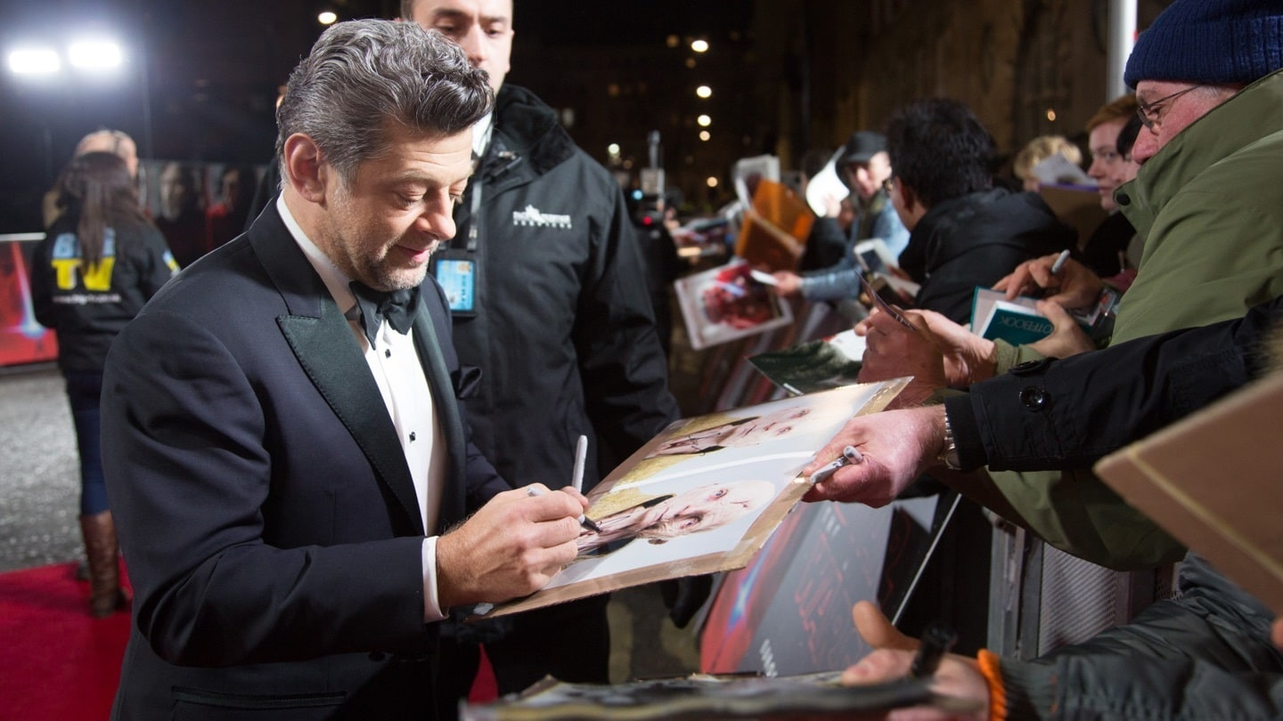 Andy Serkis signing autographs on the red carpet at the Star: Wars The Last Jedi premiere