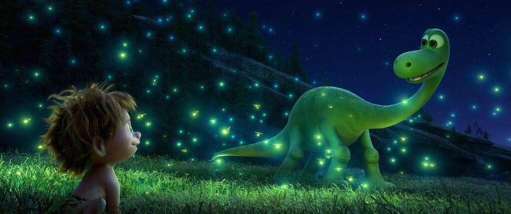 "Raymond Ochoa (Aldo) and Jack Bright (Spot) surrounded by fireflies in ""The Good Dinosaur"""