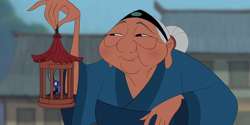"Character Grandmother Fa holding a caged cricket in the animated movie ""Mulan"""