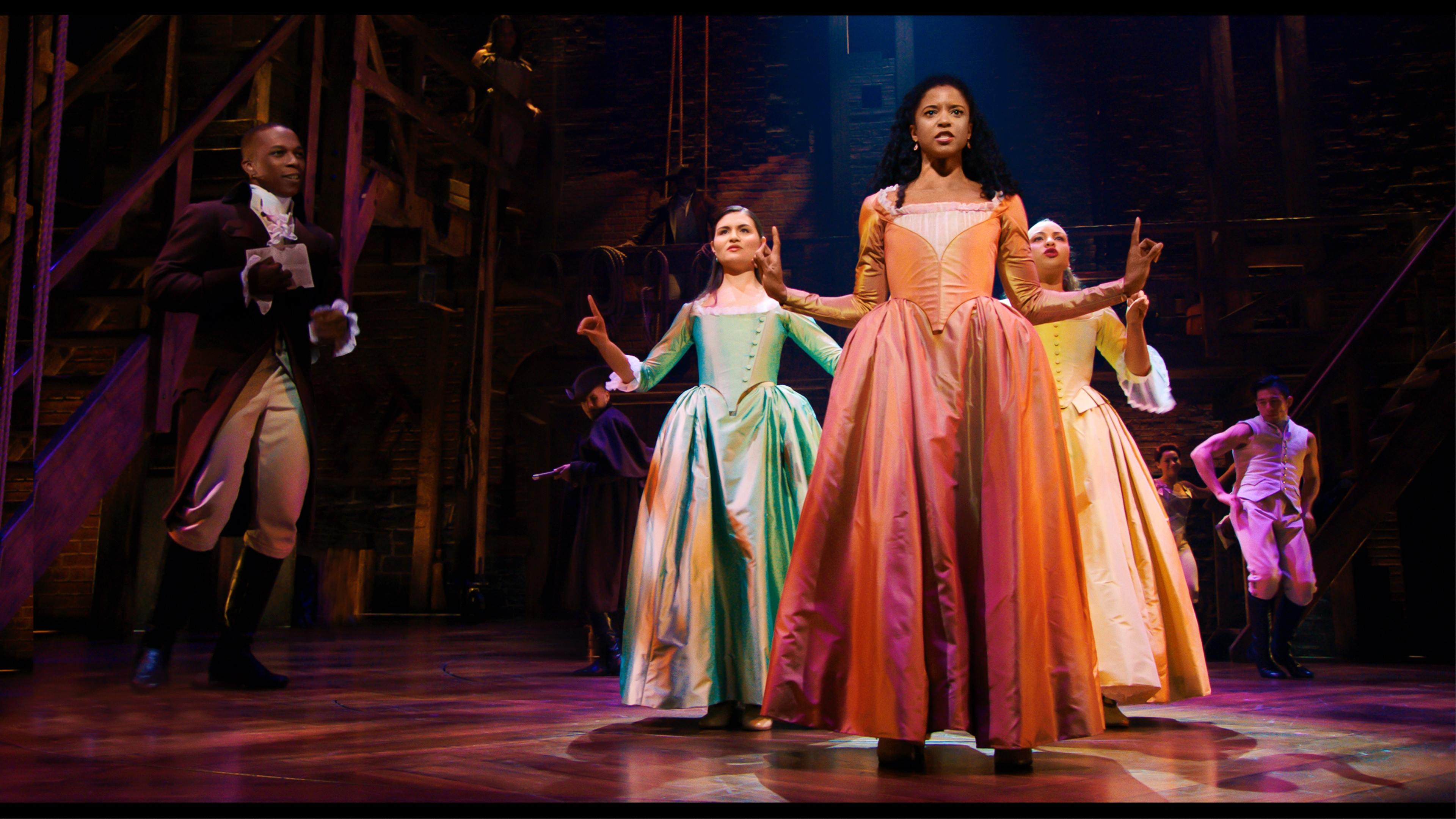 Phillipa Soo is Eliza Hamilton, Renée Elise Goldsberry is Angelica Schuyler and Jasmine Cephas Jones is Peggy Schuyler in HAMILTON, the filmed version of the original Broadway production.