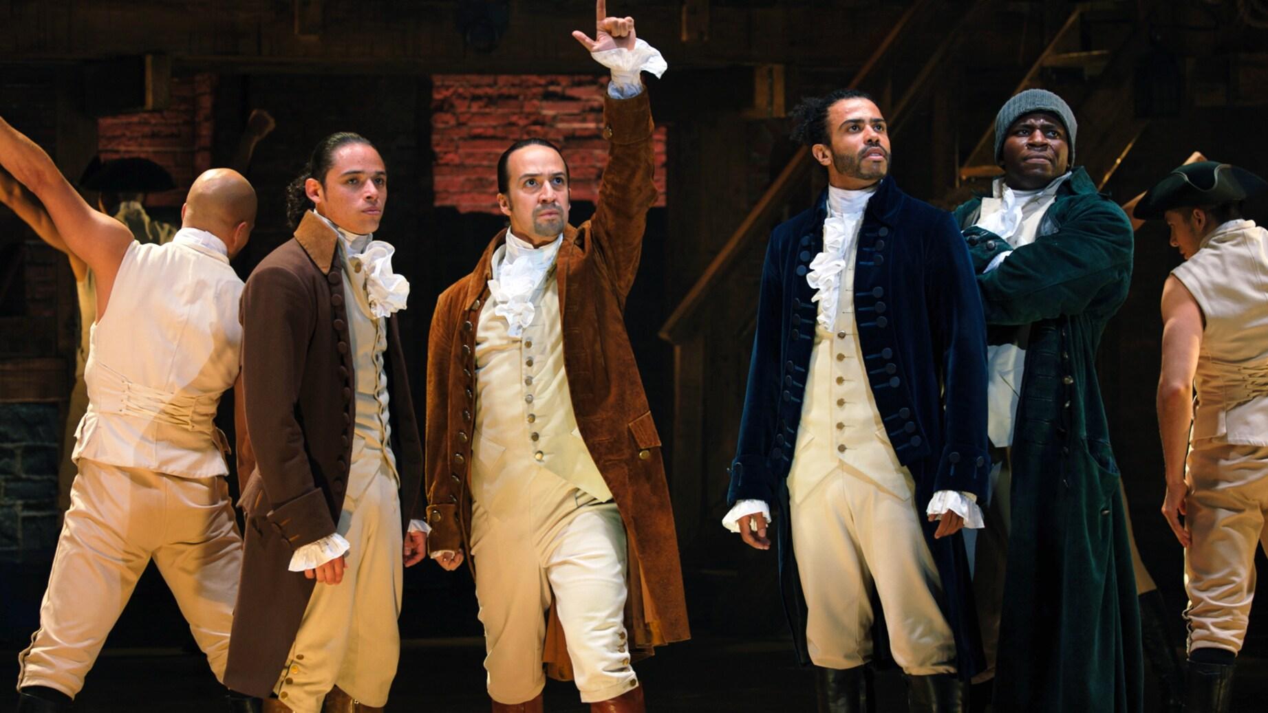 (L-R): Anthony Ramos is John Laurens, Lin-Manuel Miranda is Alexander Hamilton, Daveed Diggs is the Marquis de Lafayette, and Okieriete Onaodowan is Hercules Mulligan in HAMILTON, the filmed version of the original Broadway production.