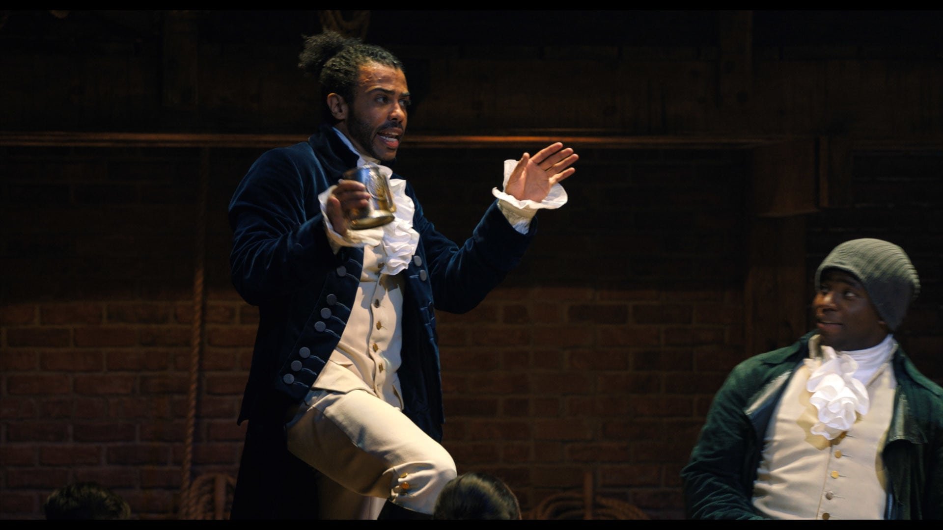 Daveed Diggs is Marquis de Lafayette and Okieriete Onaodowan is Hercules Mulligan in HAMILTON, the filmed version of the original Broadway production.
