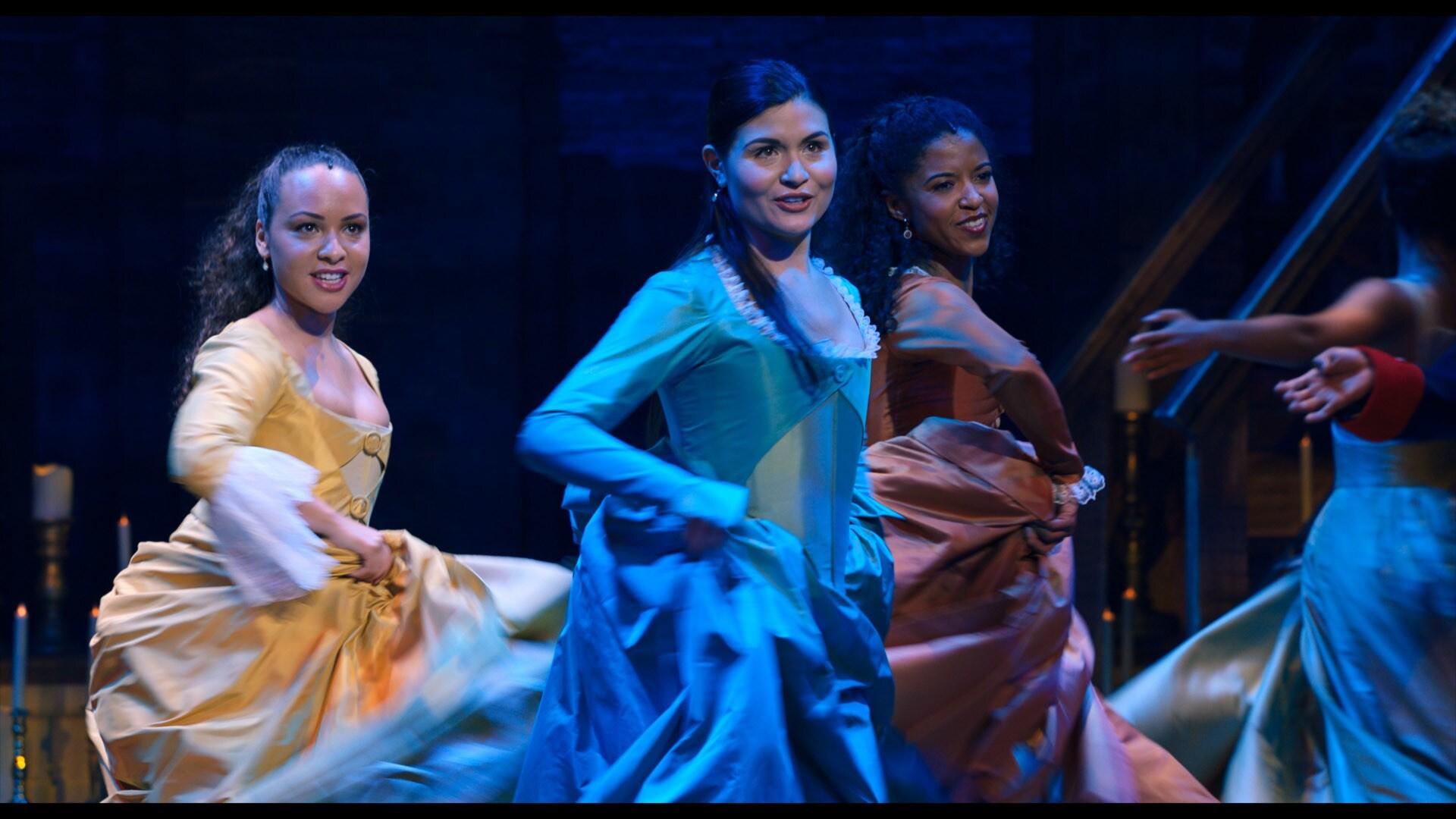 Jasmine Cephas Jones is Peggy Schuyler, Phillipa Soo is Eliza Hamilton and Renée Elise Goldsberry is Angelica Schuyler in HAMILTON, the filmed version of the original Broadway production.