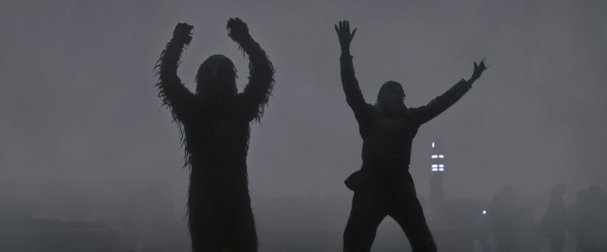 Chewbacca and Han Solo raising their hands in surrender