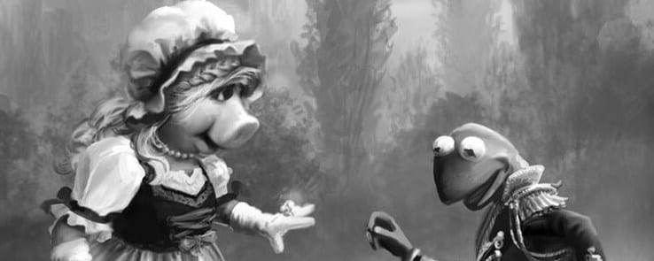 Black and white image of Miss Piggy and Kermit