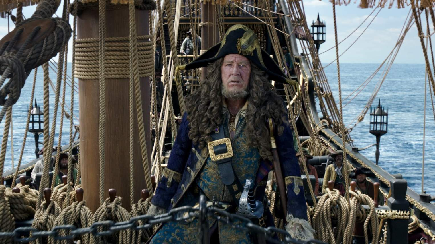 Captain Hector Barbossa, played by Geoffrey Rush, on a shop in a the middle of the ocean in the movie Pirates of the Caribbean: Dead Men Tell No Tales