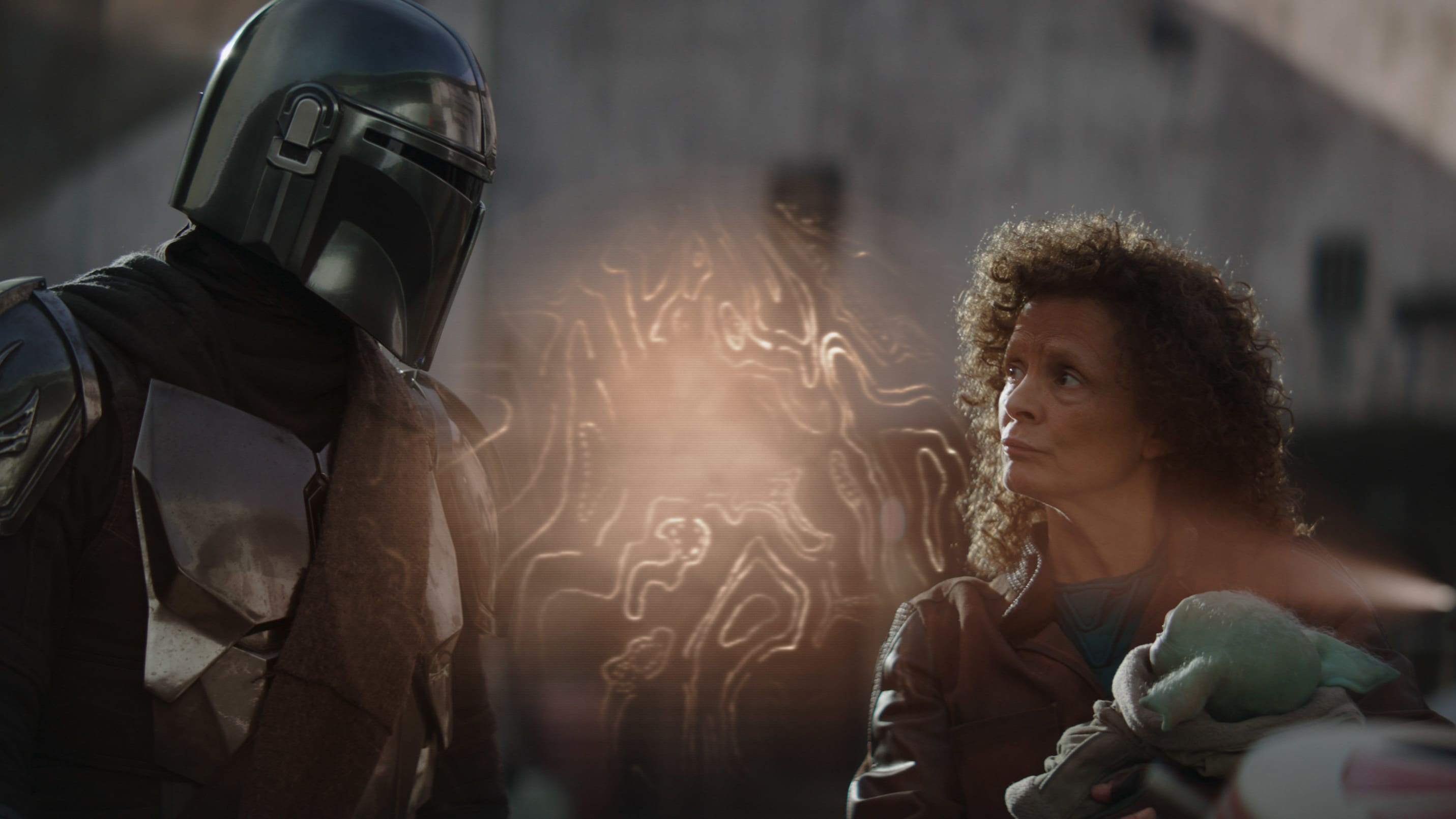 The Mandalorian (Pedro Pascal), Peli Motto (Amy Sedaris) and the Child in Lucasfilm's THE MANDALORIAN, season two, exclusively on Disney+. © 2020 Lucasfilm Ltd. & ™. All Rights Reserved.