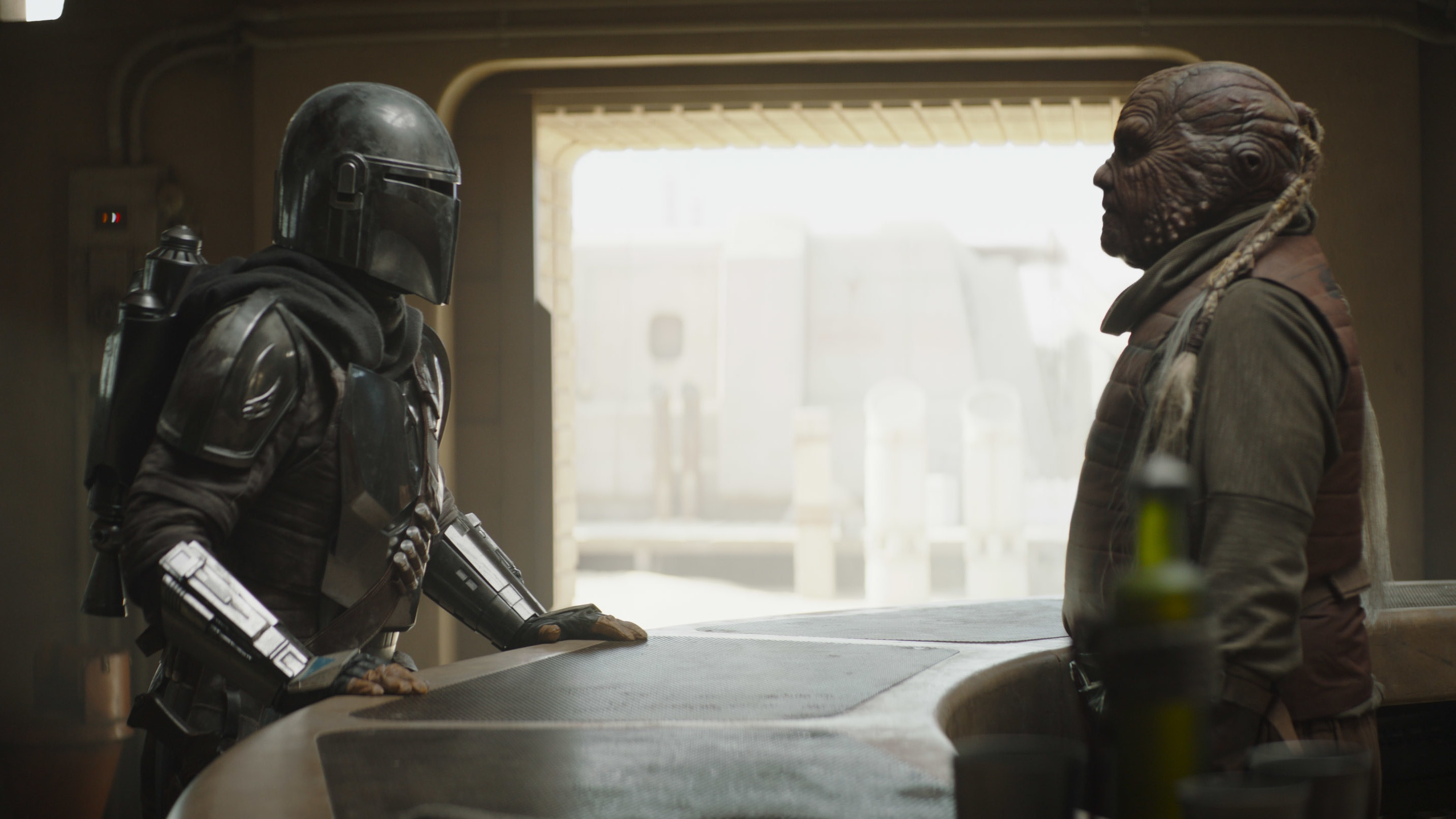 The Mandalorian (Pedro Pascal) and Weequay bartender in Lucasfilm's THE MANDALORIAN, season two, exclusively on Disney+. © 2020 Lucasfilm Ltd. & ™. All Rights Reserved.