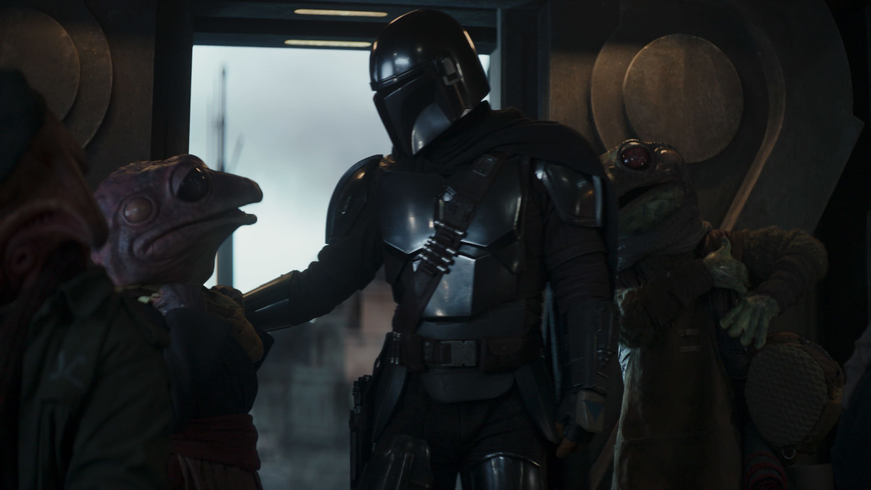 (Center, l-r): Frog Lady and the Mandalorian (Pedro Pascal) in Lucasfilm's THE MANDALORIAN, season two, exclusively on Disney+. © 2020 Lucasfilm Ltd. & ™. All Rights Reserved.