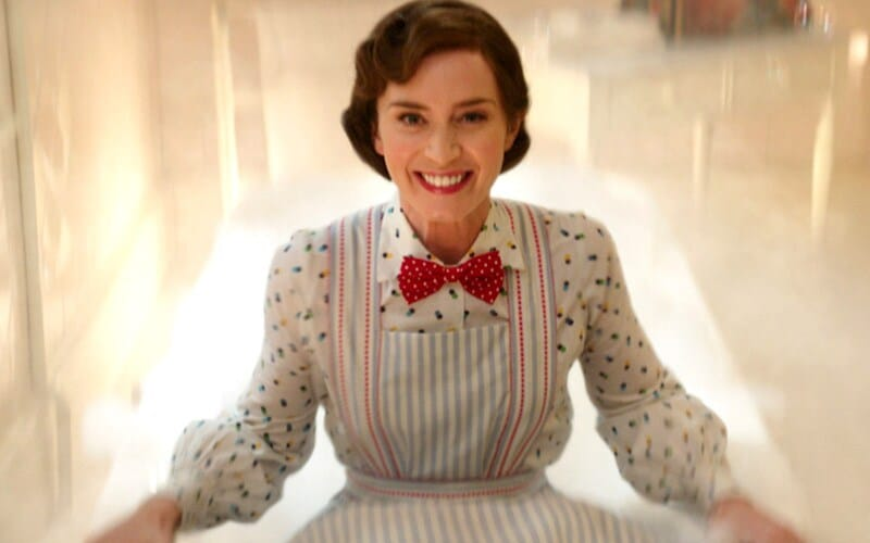 Mary Poppins wearing an apron and read bow tie