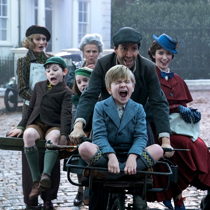 Banks children screaming while riding a bicycle with Jack and Mary Poppins.