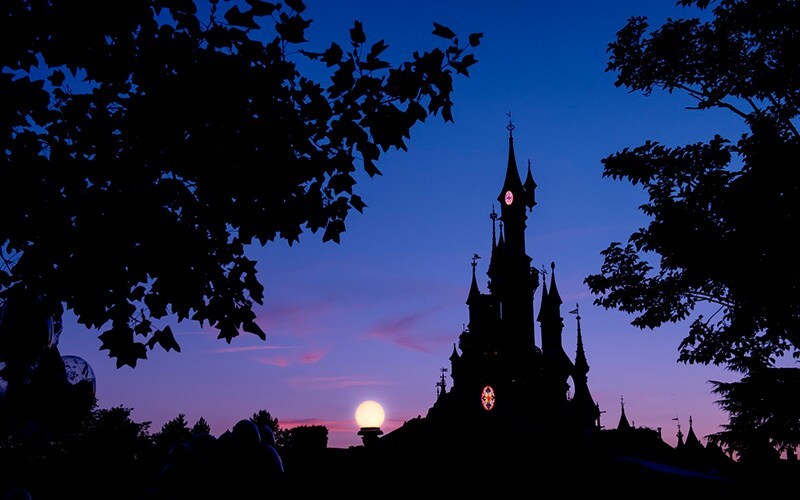 Sleeping Beauty's Castle during sunset at Disneyland Paris.