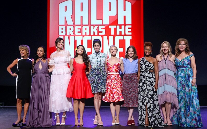 All Voice actresses of Disney Princesses on stage in front of Ralph Breaks the internet backdrop