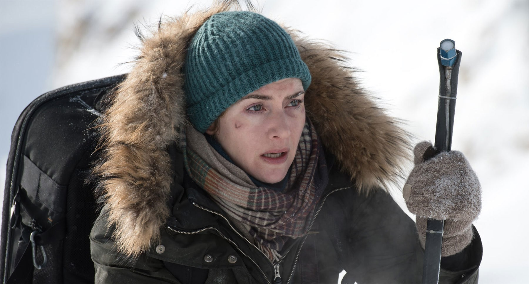 "Kate Winslet (as Alex Martin) on a snowy mountain in the movie ""The Mountain Between Us"""