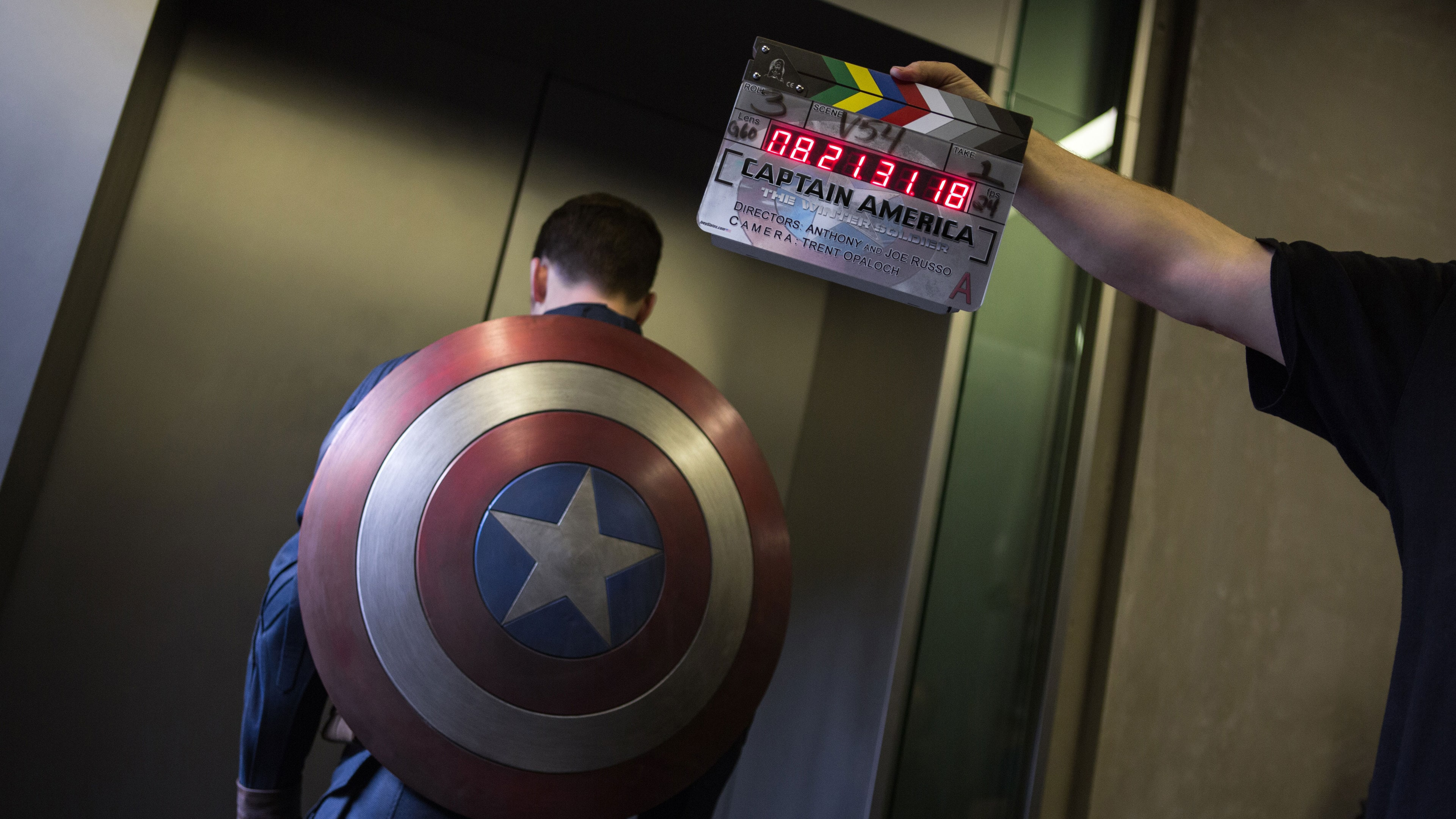 Actor Chris Evans (Steve Rogers/Captain America) behind-the-scenes standing by an elevator in Captain America: The Winter Soldier.