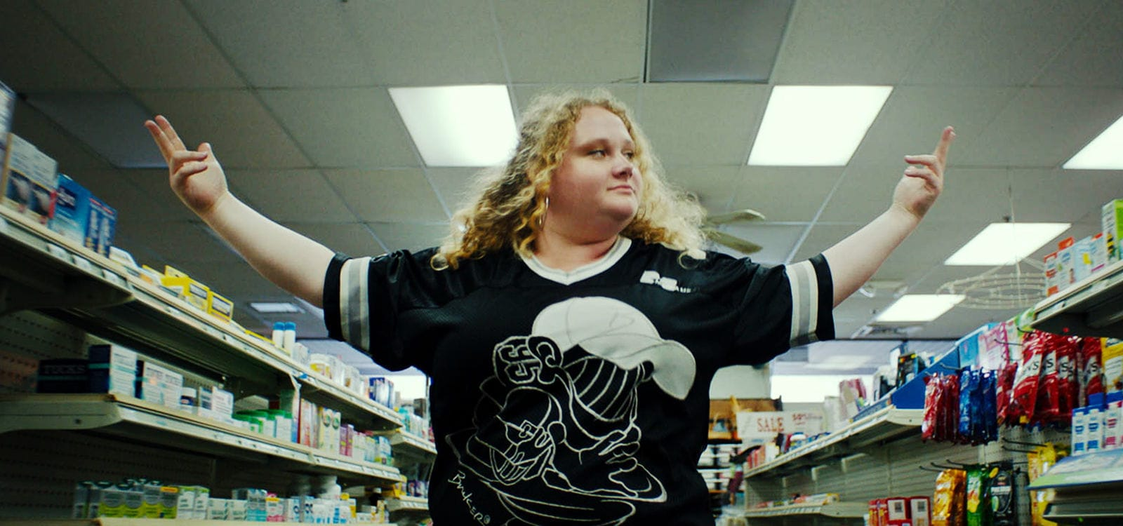 "Danielle Macdonald (as Patti) walking in a pharmacy in the movie ""Patti Cake$"""