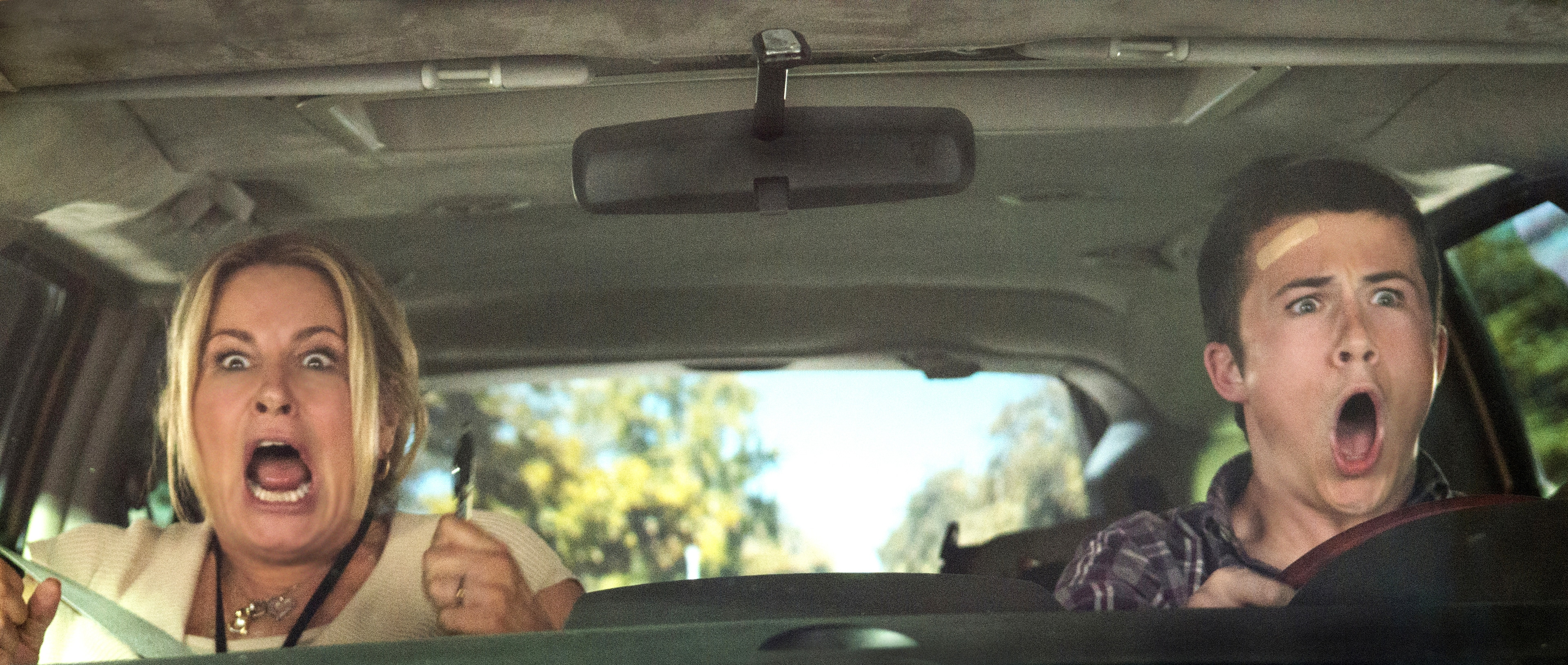Kelly and Ben Cooper driving in a car