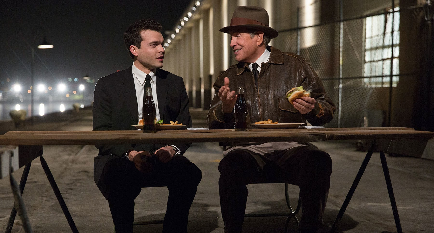 "Warren Beatty and Alden Ehrenreich eating hamburgers in ""Rules Don't Apply"""