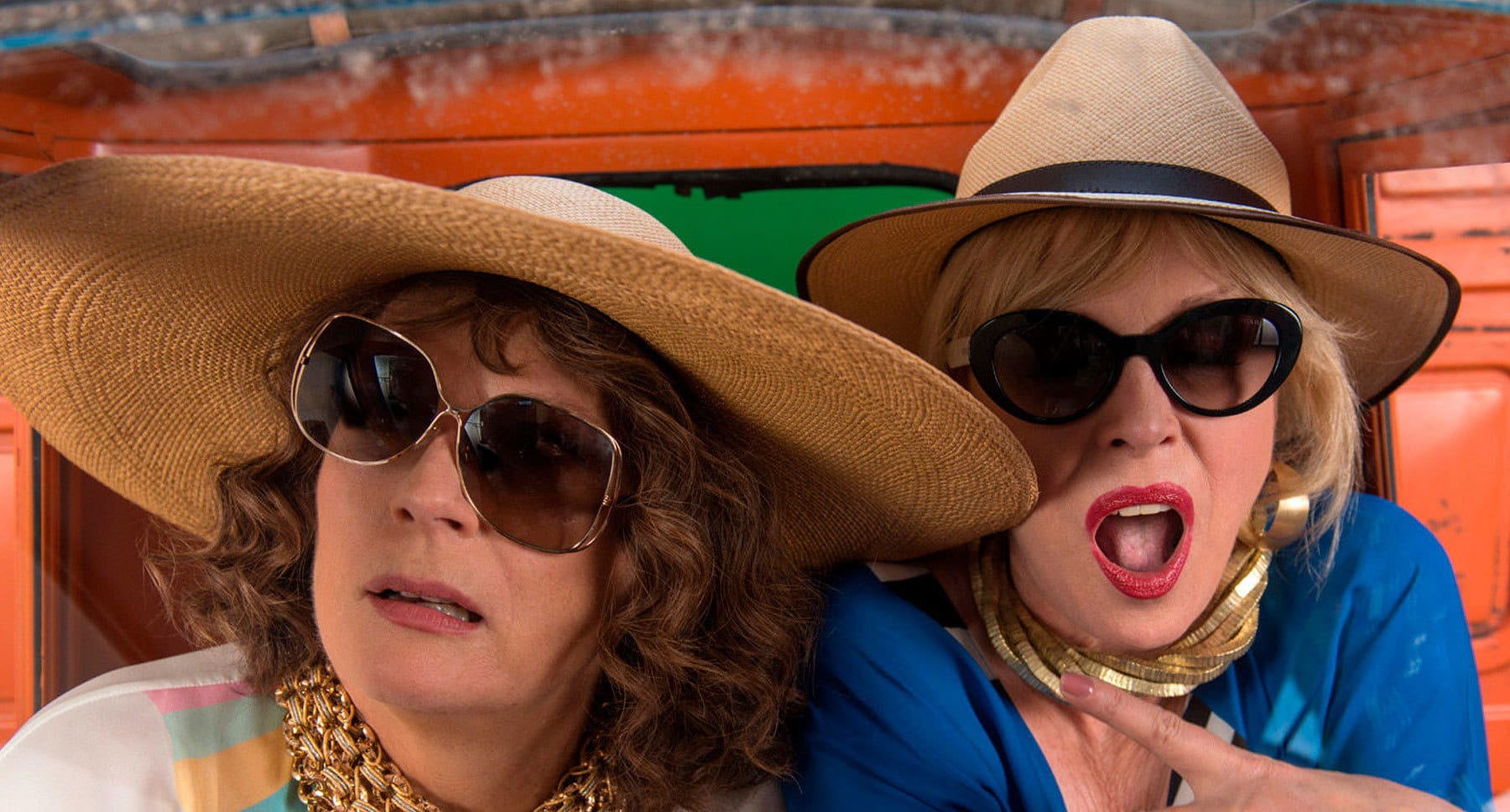 "Actors Jennifer Saunders (as Edina) and Joanna Lumley (as Patsy) wearing Straw hats and sunglasses in ""Absolutely Fabulous: The Movie"""
