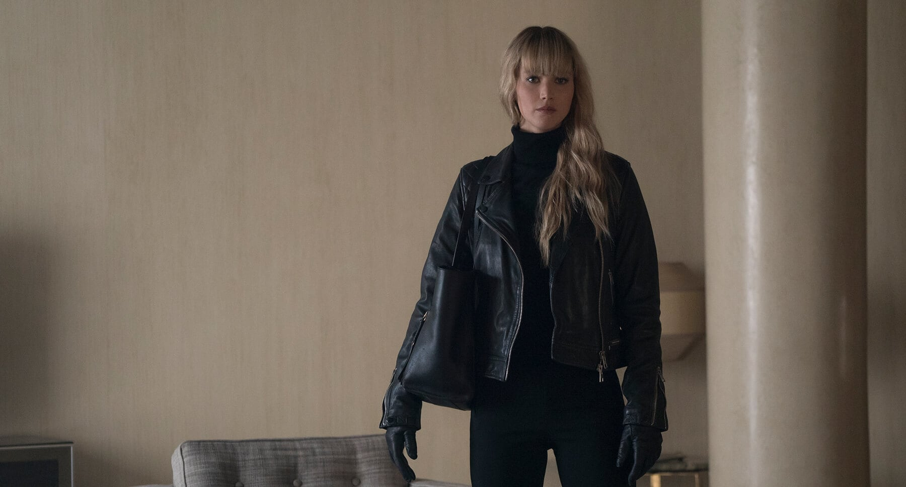 "Jennifer Lawrence (as Dominika Egorova) dressed in black standing in a room in ""Red Sparrow"""
