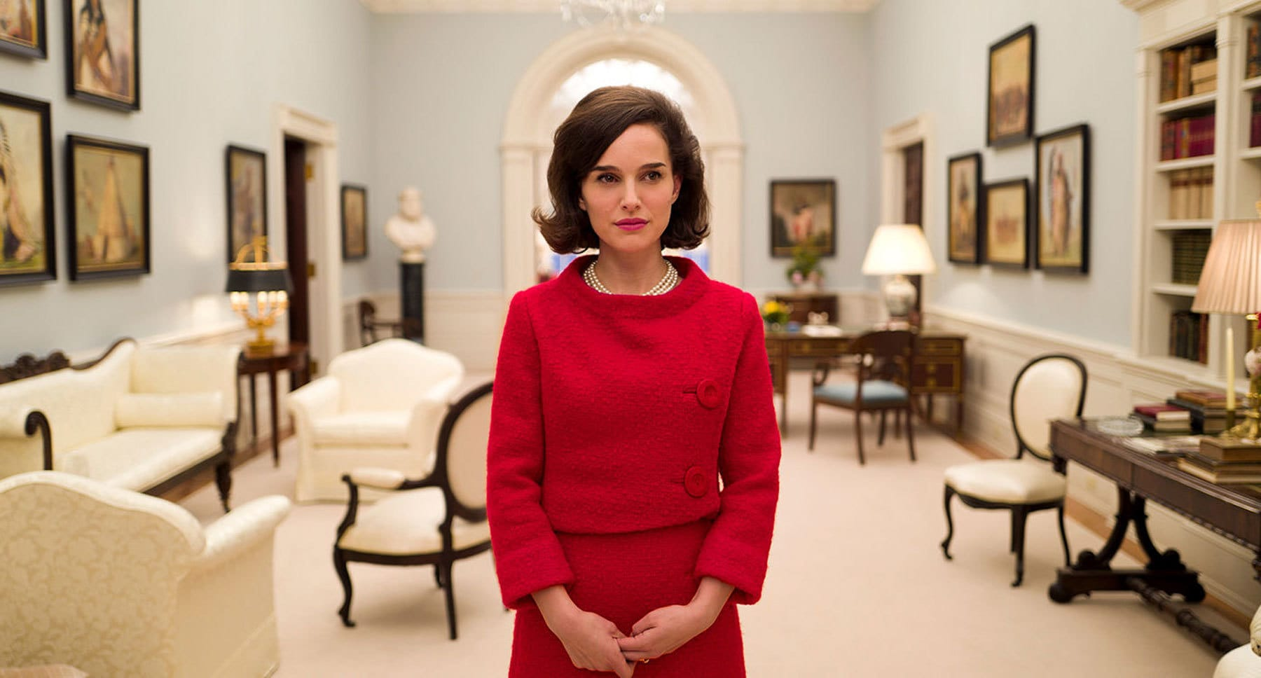 "Natalie Portman (as Jackie) wearing a red dress in ""Jackie"""
