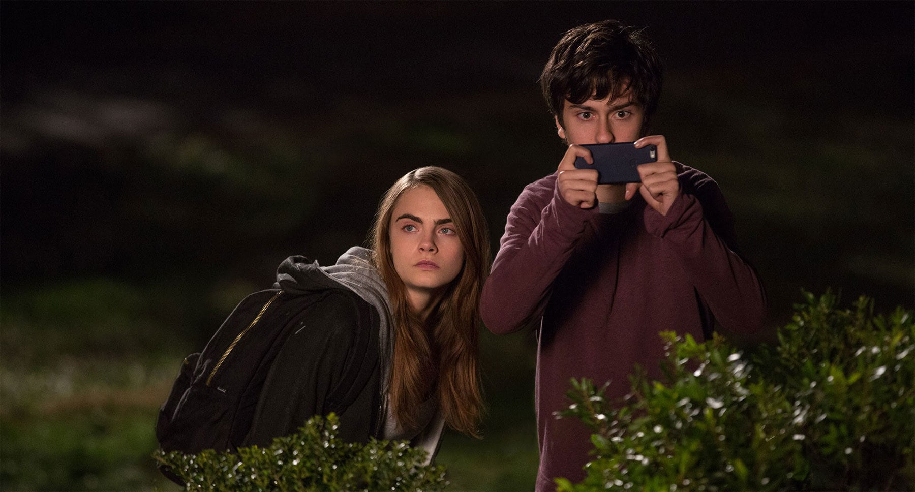 "Nat Wolff (as Quentin) and Cara Delevingne (as Margo) taking pictures with a cellphone in the movie ""Paper Towns"""