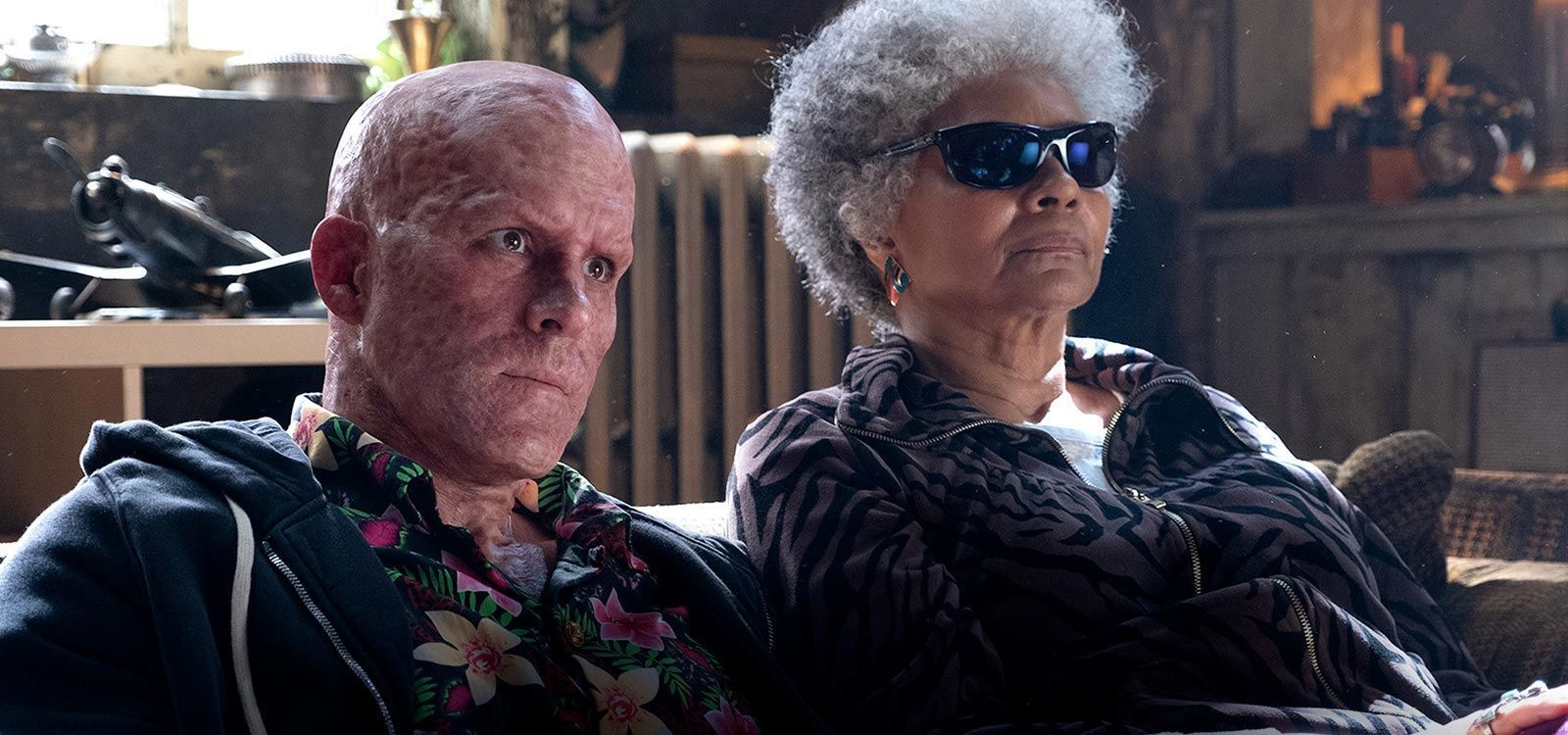 "Actors Ryan Reynolds (as Deadpool) and Leslie Uggams	 (as Blind Al) sitting together in the film ""Deadpool 2"""