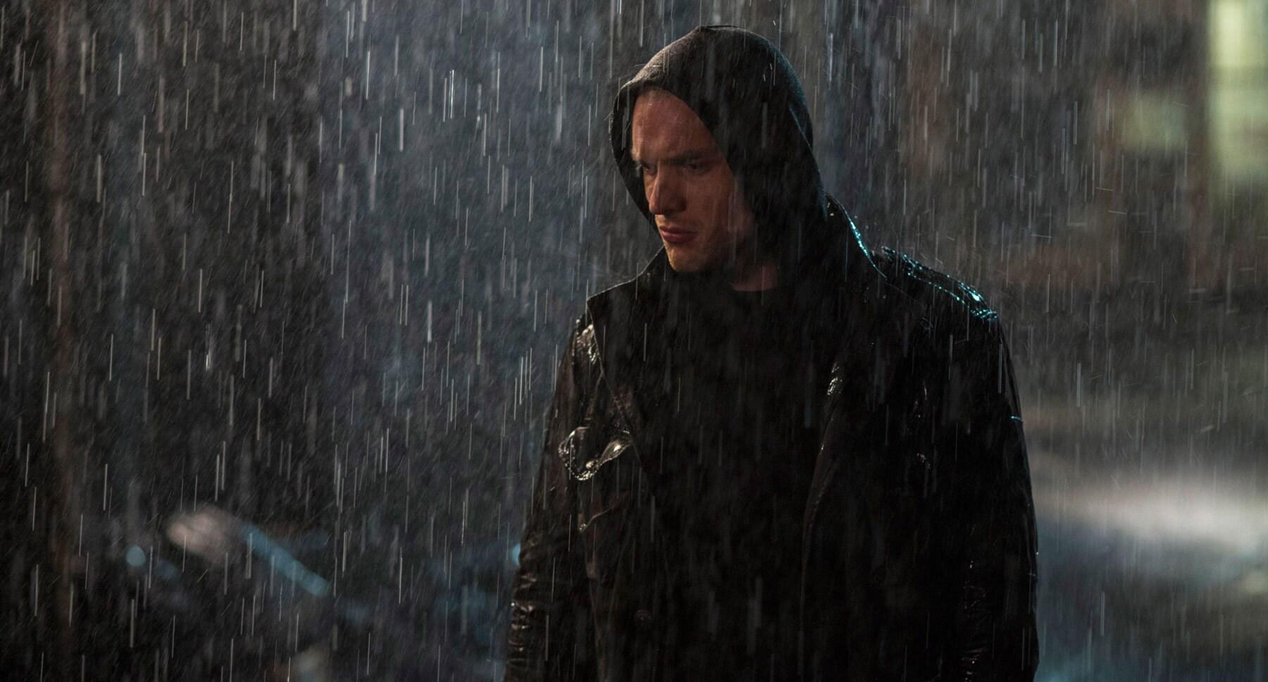"""Ed Skrein (as Ajax) standing in the rain in """"Deadpool"""""""