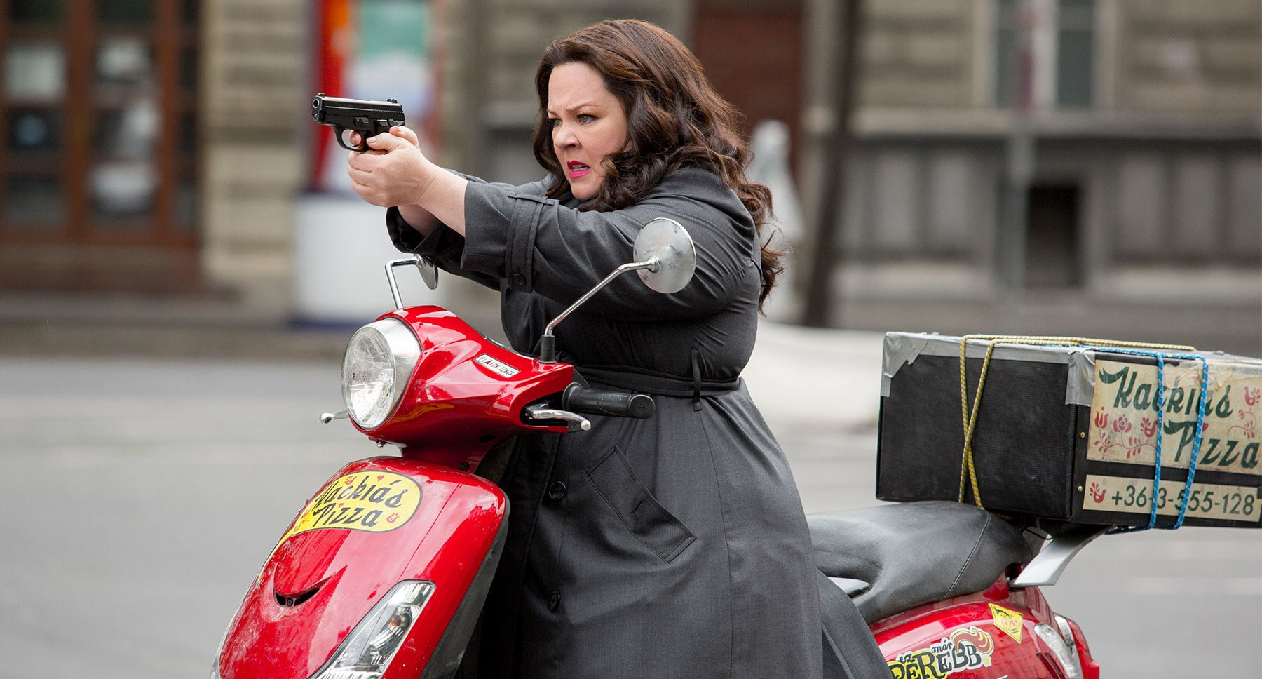 "Melissa McCarthy (as Susan Cooper) riding a scooter in ""Spy"""