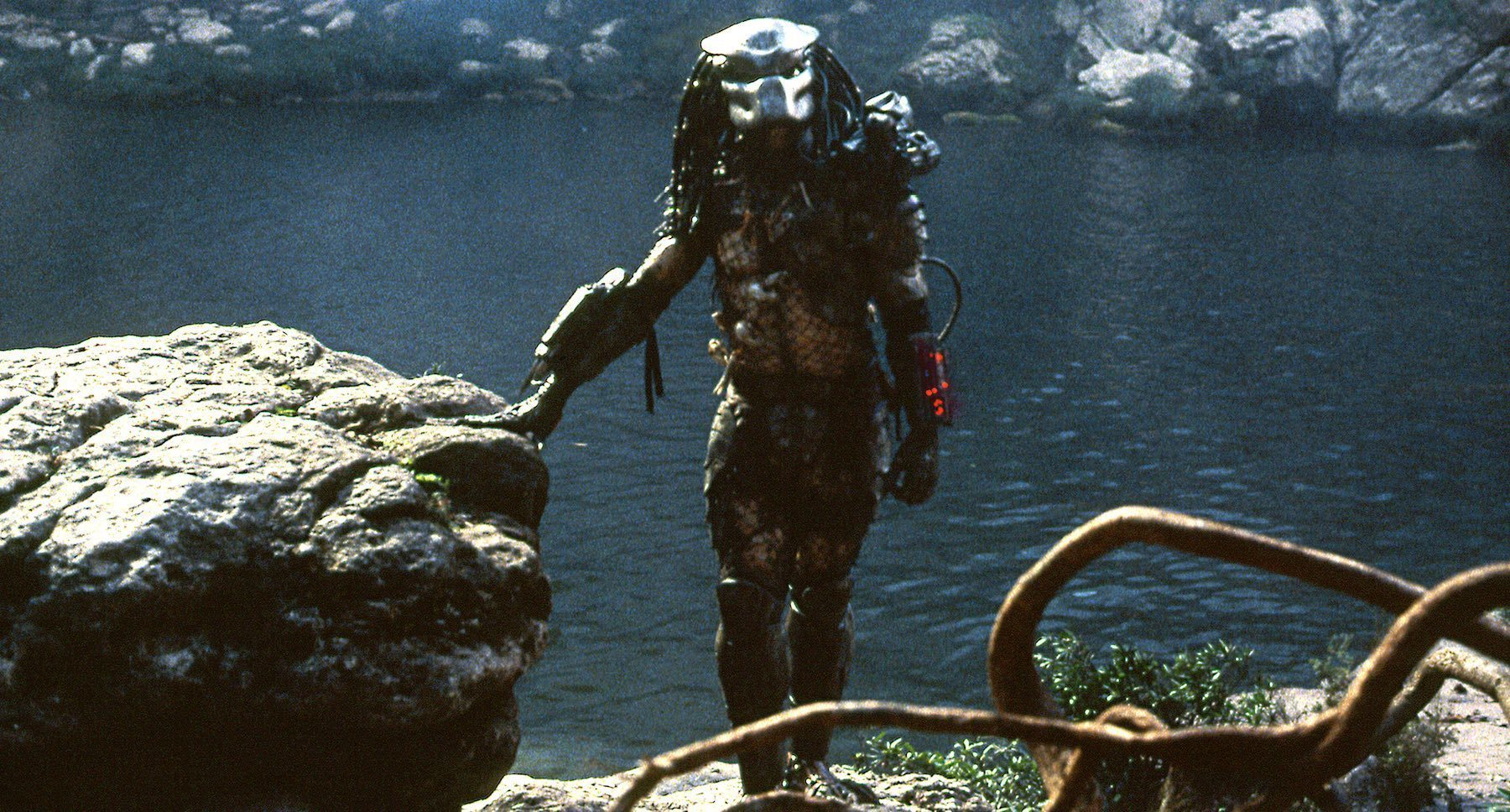 "The predator standing next to a body of water in the movie ""Predator"""
