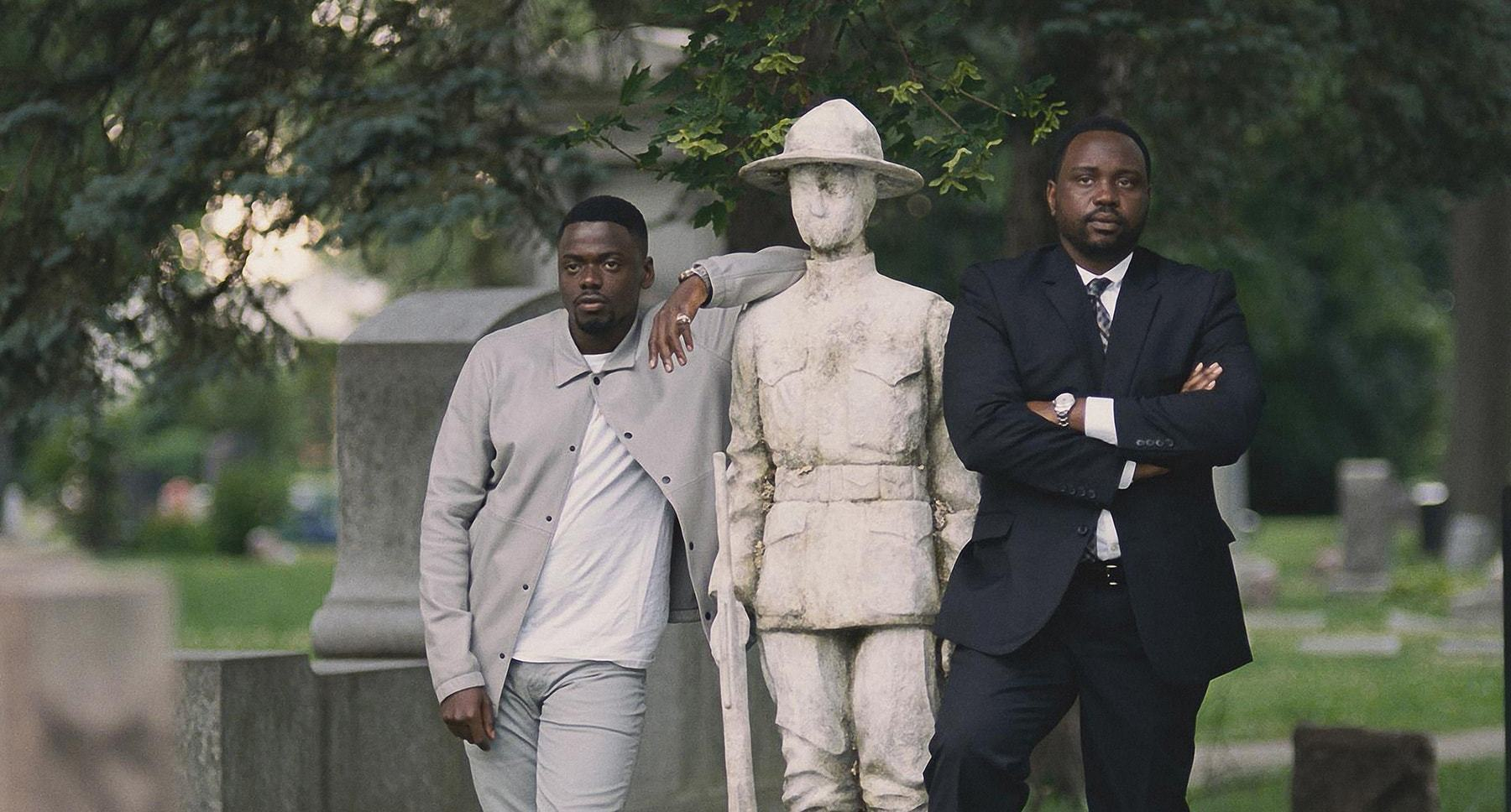 "Daniel Kaluuya and Brian Tyree Henry next to a statue in ""Widows"""