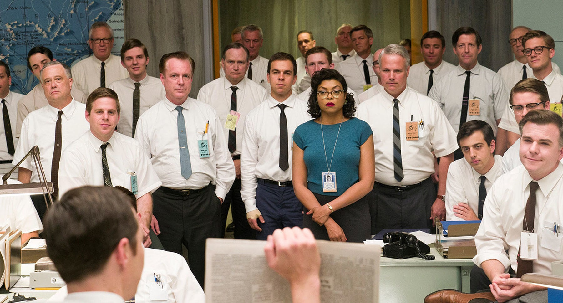 "Actor Taraji P. Henson surrounded by men who work at NASA in the movie ""Hidden Figures"""